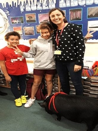 micro pig Mikey at a school