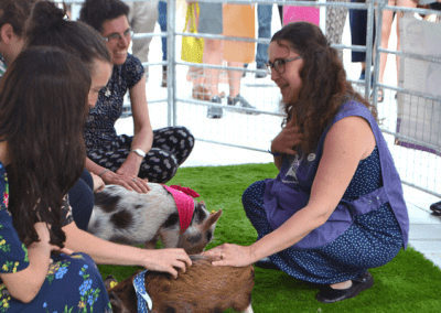 Natasha and Holly and Polly during the Therapy Pig Session at Victoria and Albert Museum London