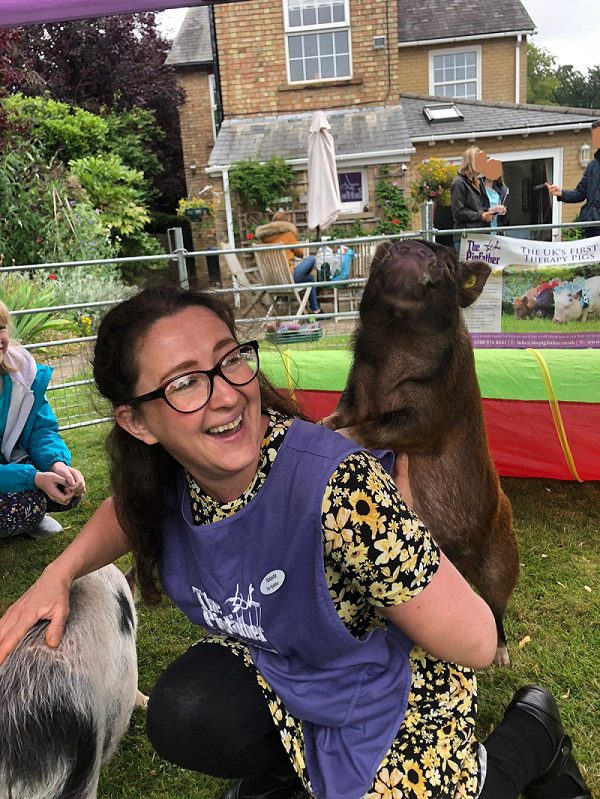 Piggy Back with Miniature Pig Ella during a therapy visit in Lincolnshire