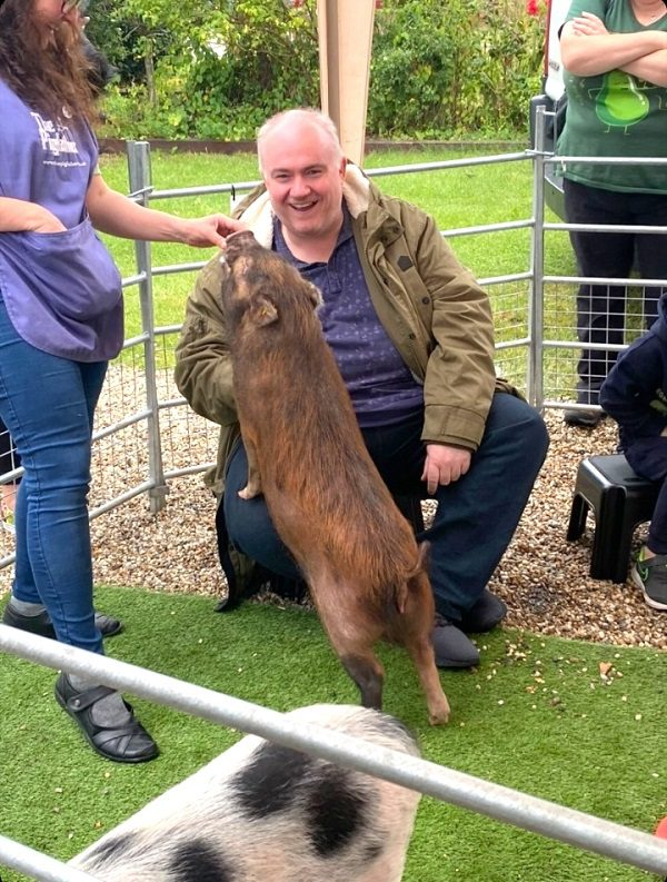 Miniature Pig Ella making everyone happy at a Party in Essex